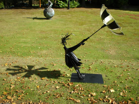 Garden Sculpture - Girl with umbrella in the wind - Pulborough West Sussex Sculptor and Artist Jericho