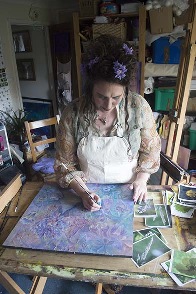 West Sussex Artist Claire Harrison working in her art studio